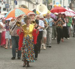 The Brolly Parade - swinging down Kirkcudbright's streets!